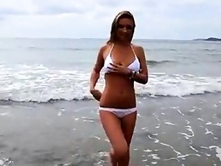 Dionne Daniels strips on the beach