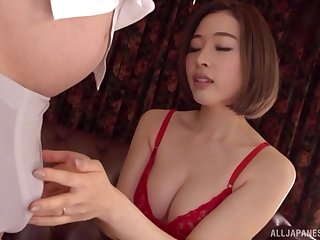 Japanese brunette MILF Honda Misaki takes not present will not hear of bra and sucks flannel