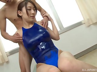Oiled up Japanese babe Kashii Ria gives a blowjob in public